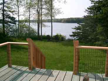 View The Dow Road Waterfront Cottage
