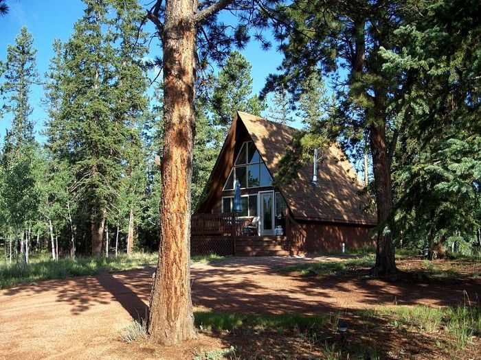 View Whispering Pines Cottage