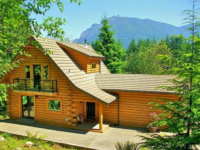 View Luxurious Riverfront Log Home
