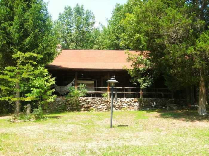 View The Lonesome Dove Log Cabin